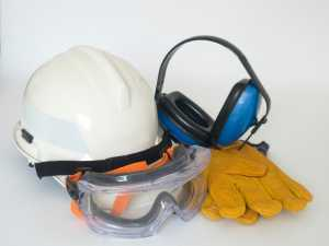 Equipment for cutting concrete: a helmet, gloves and headpones