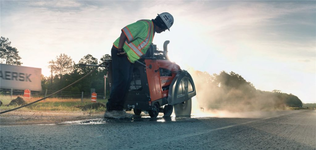 Engineer Cutting Concrete Road